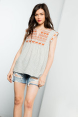 top with burnt orange embroidery