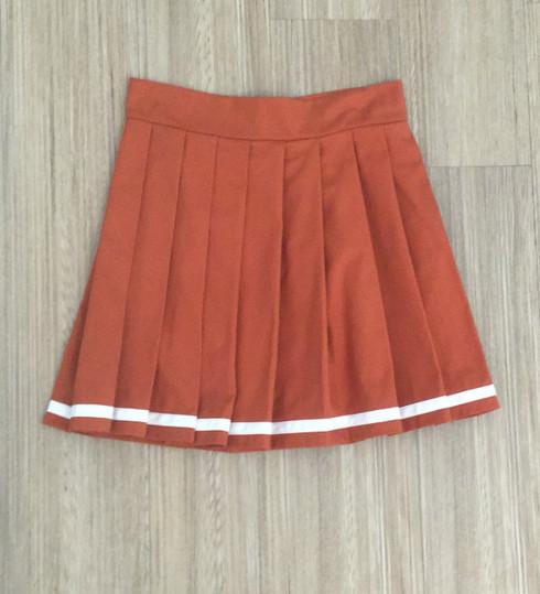 burnt orange pleated skirt