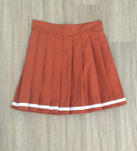 burnt orange pleated skirt
