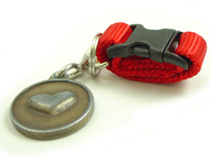 Removable Pet ID Tag Holders Make it a Snap to Move ID Tags from One Collar to Another.