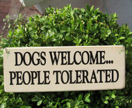 "Make your position know with one of these ""Dogs Welcome...People Tolerated"" wood signs made in U.S."