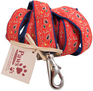 Warm orange floral ribbon embellishes our hemp dog leashes.