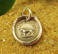 An antique wax seal is used to create our faithful dog charms.
