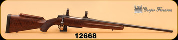 """Consign - Cooper - 6.5x284 - M52 - Jackson Game, Wd/Bl, 24"""" Less than 20 rounds fired, c/w green soft case"""