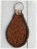 Handmade brown ostrich skin keychain. Made in the U.S.A.