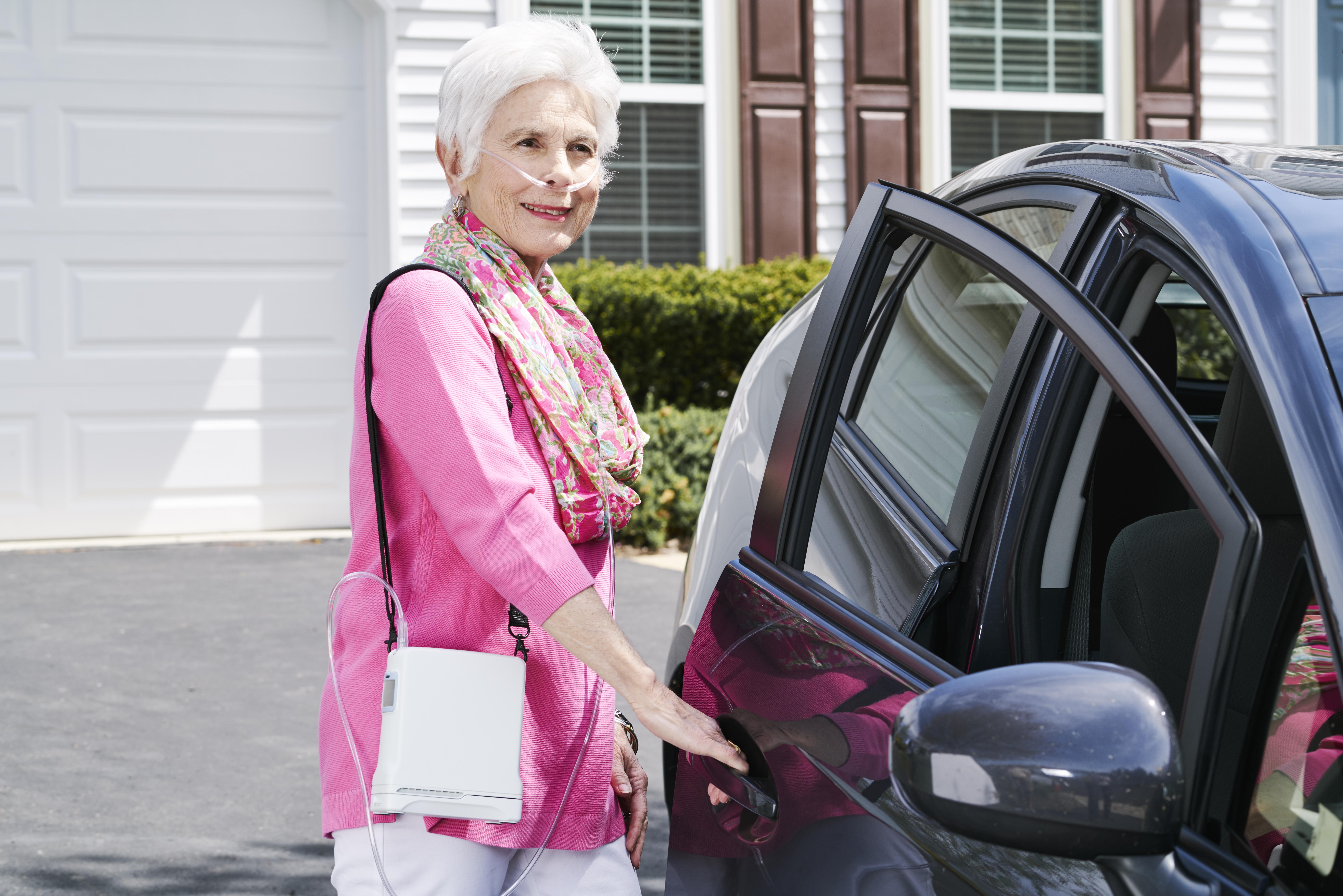 Inogen G4 Lady In Pink by Car.jpg