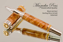 Handcrafted wood pen made from Black Ash Burl with Sterling Silver and Gold finish.  Side view of pen and cap.