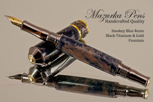Handmade Smokey Blue Resin Fountain Pen with Black Titanium / Gold trim.  Cap view of pen.