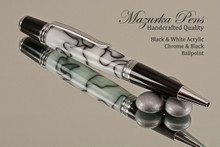 Handcrafted pen made from swirling White and Black Acrylic with Chrome finish and Black accents.  Handcrafted pen by our artist.  Tip of the pen,