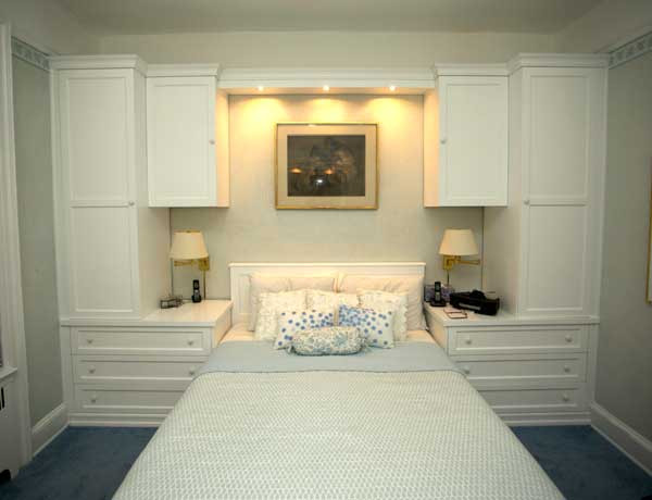 custom made white built in wall unit with bed