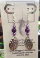 Purple pearl beads with Diamond style (Pineapple) spinner blades.  Sterling Silver earrings.
