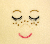 Embroidered Doll Face with Freckles Embroidery Machine Design