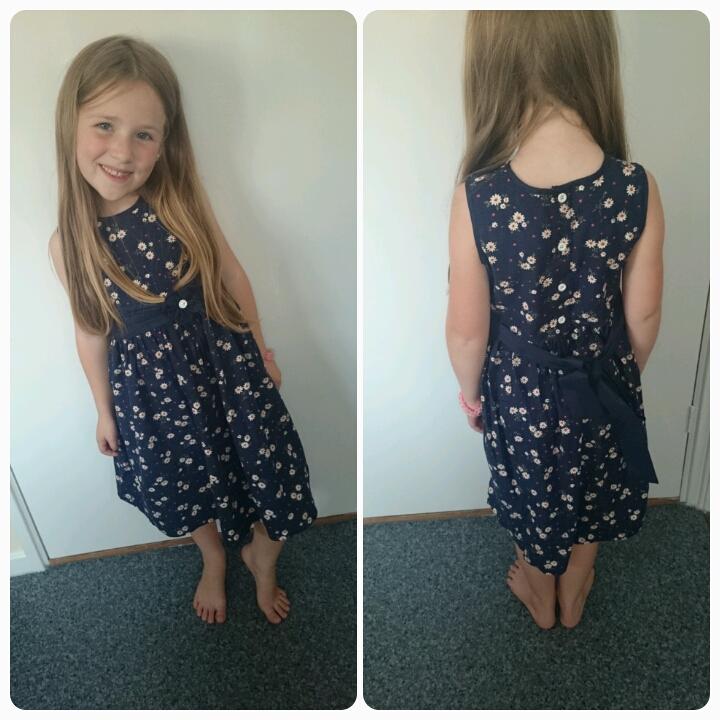 Child Wearing A Dress