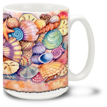 Lovely watercolor sea shells bring the bright and vivid beach to your favorite cup of coffee! 15oz Beach Coffee Mug is dishwasher and microwave safe.