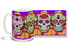 Bright and snappy purple theme, pretty flowers and four different vivid sugar skulls make this Day of the Dead skull mug a keeper! Skulls coffee mug is durable, dishwasher and microwave safe.