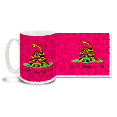"A pink and colorful twist on the historic Gadsden Flag design showing a coiled snake ready to strike on a wild pink field bears the words ""Don't Tread On Me"". Big 15-ounce ceramic coffee mug has comfortable 4-finger handle."