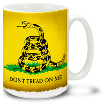 """This historic American flag showing a coiled snake ready to strike on a yellow field bears the words """"Don't Tread On Me"""". Designed by American general Christopher Gadsen, the flag on this Gadsden Flag coffee mug was used by the Continental Marines as an early motto flag. 15oz Don't Tread on Me Mug is dishwasher and microwave safe."""