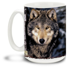 A majestic lone wolf peering from the forest. By reknowned wildlife photographer Ken Jenkins. 15oz coffee mug