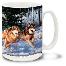 A pack of wolves run through the crisp, freshly fallen snow. Speed and grace describe this wolf pack! By famed wildlife artists the Hautman Brothers. 15oz coffee mug
