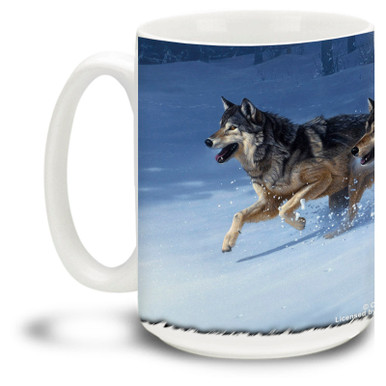 A hearty wolf pack runs in the winter forest. These wolves are after something primal! 15oz coffee mug