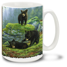 Playful bear cubs are as cute as can be in this beautiful forest scene.