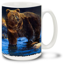 This mighty bear is looking for fish by the river's edge.