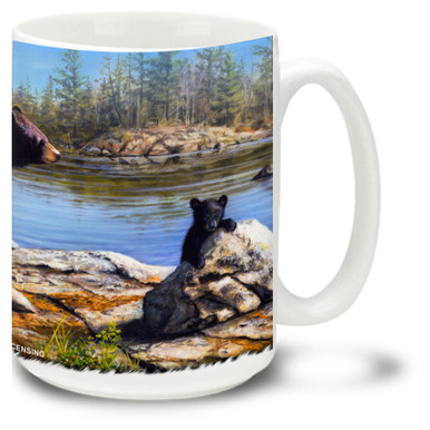 Majestic and playful Black Bears roam the riverbanks.