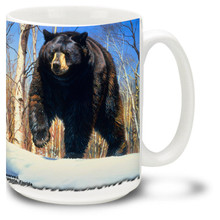 This powerful majestic Bear is on the hunt against a snowy backdrop.
