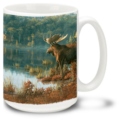 A beautiful Moose among a lake and trees.