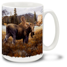 Beautiful moose against mountains & trees.