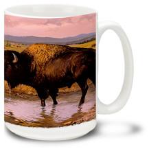 Beautiful Buffalo in a field by a stream.