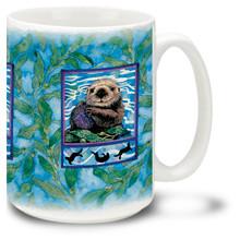 Cute Sea Otters frolic in the water.
