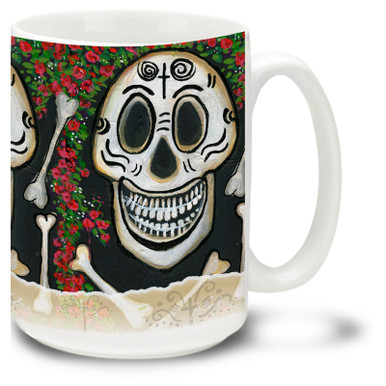 Colorful roses adorn this festive skull and bones mug celebrating the Day of the Dead