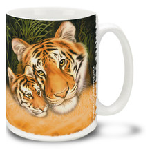 A proud and beautiful mother tiger, known as a tigress, is responsible for raising the tiger cubs as well as teaching them to hunt and fend for themselves. Prowl through your day with this colorful tiger mug. 15oz Cub and Mama Tiger coffee mug is durable, dishwasher and microwave safe.
