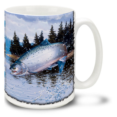"""Coho salmon are also known as silver salmon or """"silvers"""". Upon entering fresh water, these distinctive fish develop coloring that includes bright red sides, blue-green heads and dark spots on their backs. Popular game fish, the coho salmon is both a strong fighter and a delicious meal! Savor the moment with this Coho Salmon Coffee Mug! Featuring the silver flash of a Coho breaking the surface, this vivid Coho Salmon Mug is dishwasher and microwave safe and celebrates fishing mug holds 15oz. of your favorite coffee."""