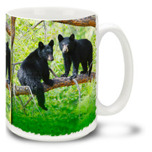 "Black bears prefer forested areas, and these little cubs are having fun exploring their surroundings! Climb out of bed in the morning with this black bear cub coffee mug. 15oz Black Bear Cub coffee mug is durable, dishwasher and microwave safe. Have yourself a ""cub"" of coffee!"