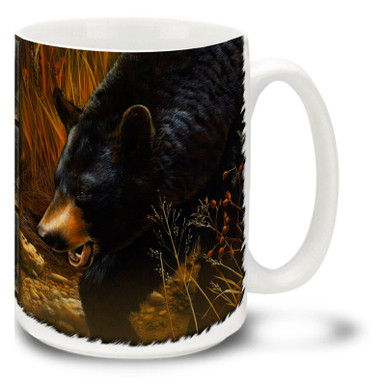 Black bears are largely vegetarian, but they certainly like to have a nice fish dinner on occasion! Black bears are also fond of honey - and bees! Black bears eat many insects and actually do dine on bees as well as honey. This fellow has certainly caught the scent of something good!  Fall is in the air with this Scent of Autumn Black Bear Mug. This 15oz Black Bear coffee mug is durable, dishwasher and microwave safe.