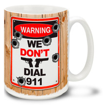 Tell it like it is with this We Don't Dial 911 gun coffee mug complete with bullet holes. We Don't Dial 911 gun mug is dishwasher and microwave safe.
