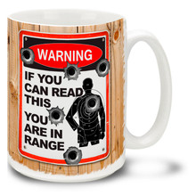 Tell it like it is with this Warning: If You Can Read This You Are In Range gun coffee mug complete with bullet holes and shooting target. Fun Warning Sign gun mug is dishwasher and microwave safe.