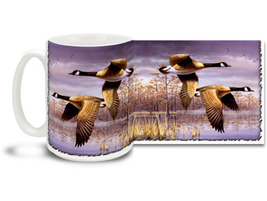 Take flight every morning with this Geese in Flight coffee mug. 15oz Goose coffee mug is durable, dishwasher and microwave safe.