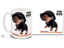 "Get up close and personal with your favorite dog breeds with ""The Dog"" mug featuring the popular Dachshund! Dachshund lovers know these scamps can be playful as well as stubborn, and often get into laundry piles and other household things that can satisfy their need to burrow and explore. Colorful 15oz The Dog Dachshund coffee mug is dishwasher and microwave safe."