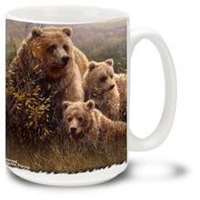 An grizzly bear family in a field. Mother and curious cubs make this a special bear mug! Grizzly bears are also known as the North American brown bear. 15oz Grizzly Bear Coffee Mug is dishwasher and microwave safe.