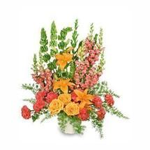 5-J maché container wet floral foam foliage: leather leaf, myrtle tips, sprengeri 10 hot pink carnations 3 orange roses 2 stems orange lilies 3 bells of Ireland 6 peach snapdragons ('Talisman'