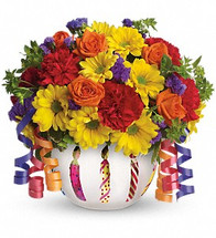 Birthday wishes can come true even before the cake is served when you send this brilliant arrangement! Bright flowers fill a frosted glass bowl that's adorned with a shiny birthday candle motif. It makes a beautiful party centerpiece and a thoughtful gift!
