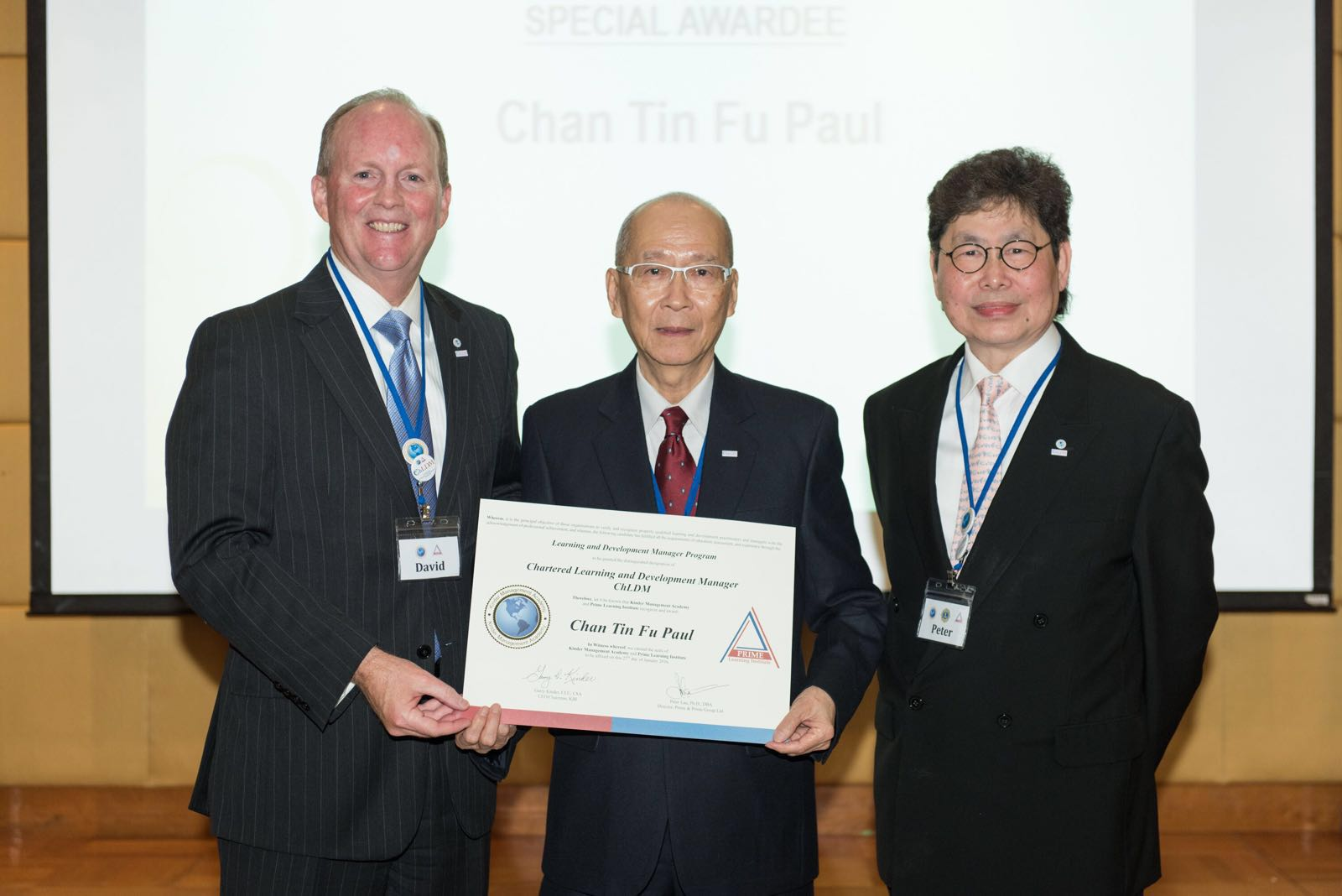 President David Smith and Dr. Peter Lau presenting the ChLDM certificate to Mr. Paul Chan