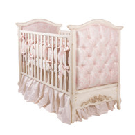 Bordeaux Crib Finish: Versailles Creme Fabric: AFK Pink Damask Tufting Option: Button Tufting Appliquéd Moulding Option: Large Bow with Roses