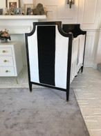 Gramercy Crib Finish: Laquered Black / Whisper White Fabric: COM Black and COM White Hardware: Polished Brass Toe Caps