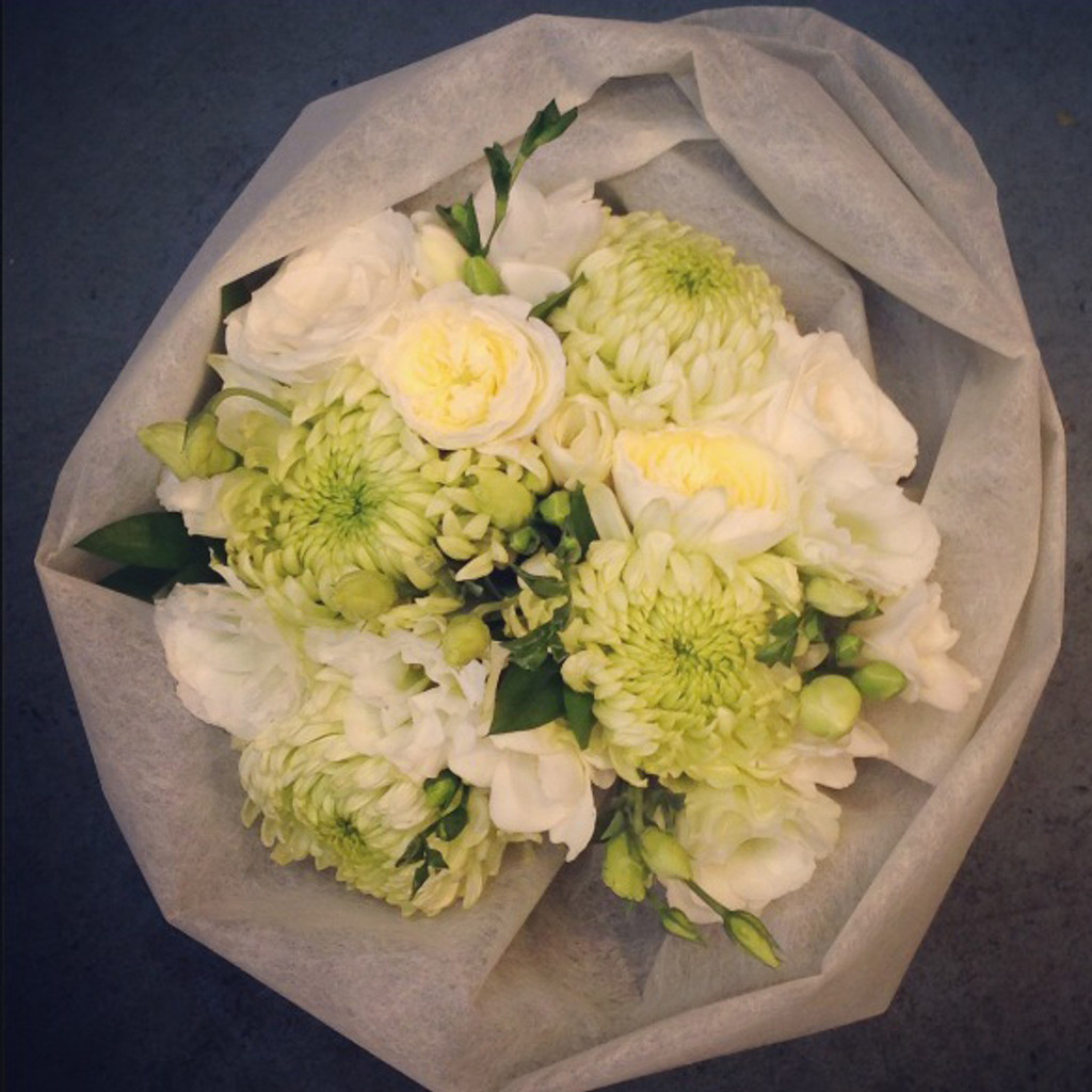 Soft Vintage style bouquet, includes roses, freesias and other vintage styled blooms in whites, creams and pale greens