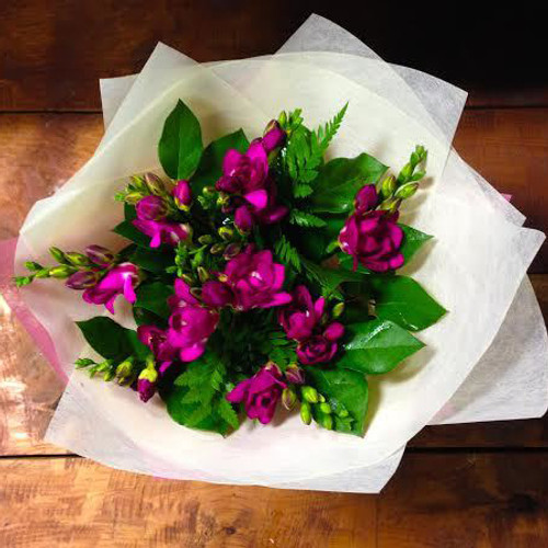 Freesia bouquet, Lovely spring flower with a familiar aroma.  Availiable in pink, red, yellow, white, purple or Mixed