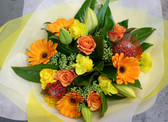 Bright sunny mixture of Gerbers, lilies, roses and seasonal blooms